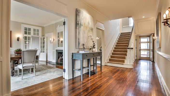 "<p>The listing calls the main level ""a master class in symmetry,"" and we struggle to disagree. The home's high ceilings, moldings, and abundance of light are all things that architect Neel Reid was famous for.</p>"