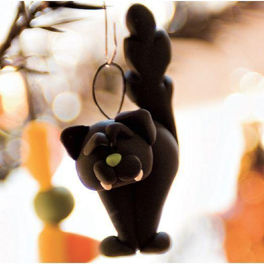 """<p>Black cats may be associated with bad luck, but this little clay black cat is about to be your new good luck charm. </p><p><strong><em><a href=""""https://www.womansday.com/home/decorating/a28904424/black-cat-clay-decorations/"""" rel=""""nofollow noopener"""" target=""""_blank"""" data-ylk=""""slk:Get the Clay Black Cat tutorial"""" class=""""link rapid-noclick-resp"""">Get the Clay Black Cat tutorial</a>. </em></strong></p><p><a class=""""link rapid-noclick-resp"""" href=""""https://www.amazon.com/Polyform-Sculpey-Polymer-8-Ounce-Black/dp/B003O2VCXK?tag=syn-yahoo-20&ascsubtag=%5Bartid%7C10070.g.2488%5Bsrc%7Cyahoo-us"""" rel=""""nofollow noopener"""" target=""""_blank"""" data-ylk=""""slk:SHOP CLAY"""">SHOP CLAY</a></p>"""