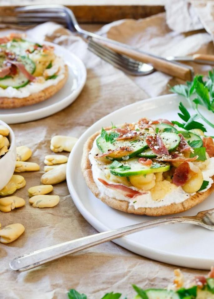 """Top <a rel=""""nofollow"""" href=""""http://www.runningtothekitchen.com/ricotta-fava-bean-grilled-pita-bites/"""">pita bread</a> with fava beans, creamy ricotta and bits of crispy prosciutto for a simple, healthymeal."""