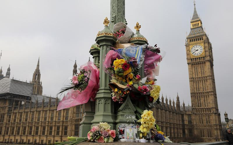 Flowers are left on Westminster Bridge by the Houses of Parliament in memory of those who died in the terror attack. - 2017 Getty Images