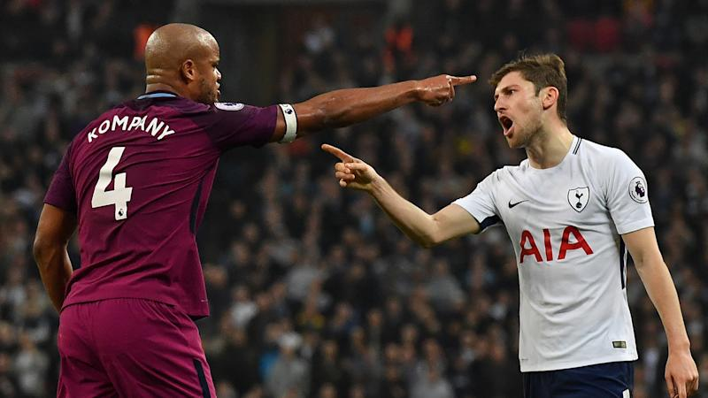 Man City top Spurs to close in on title