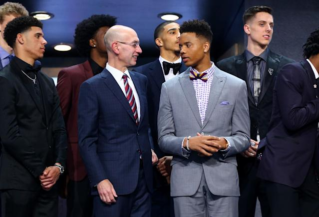 <p>NBA commissioner Adam Silver speaks to Markelle Fultz before the first round of the 2017 NBA Draft at Barclays Center on June 22, 2017 in New York City. </p>