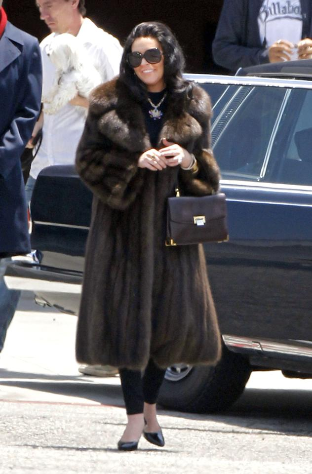 "Finally! By wearing the long fur coat and sunglasses for the scene she shot on Wednesday, Lindsay Lohan actually resembled Elizabeth Taylor on the set of the upcoming TV movie ""Liz & Dick."" Let's just hope the fur is faux ... (6/20/2012)"