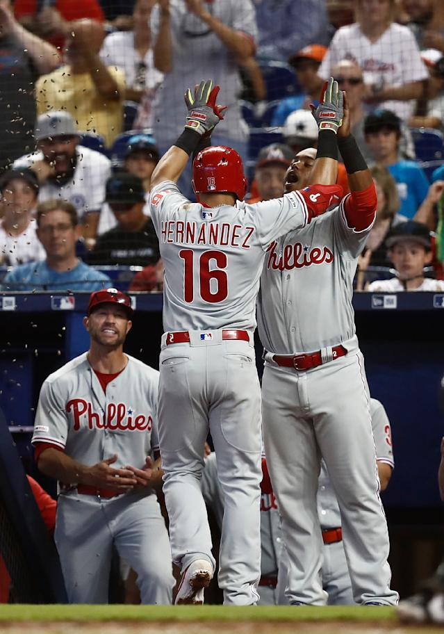Philadelphia Phillies' Cesar Hernandez (16) celebrates with shortstop Jean Segura after hitting a solo home run during the fourth inning of a baseball game against the Miami Marlins, Sunday, April 14, 2019, in Miami. (AP Photo/Brynn Anderson)