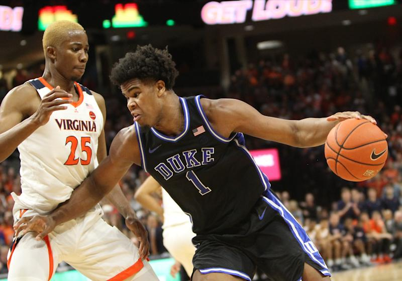 Duke Blue Devils center Vernon Carey, Jr. (1) dribbles the ball while attempting to elude Virginia Cavaliers forward Mamadi Diakite (25). (Photo by Lee Coleman/Icon Sportswire via Getty Images)