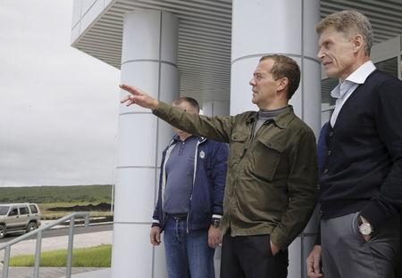 Russia's Prime Minister Dmitry Medvedev (L) speaks with acting Governor of Sakhalin region Oleg Kozhemyako as he visits Iturup Island, one of four islands known as the Southern Kurils in Russia and the Northern Territories in Japan, August 22, 2015. REUTERS/Dmitry Astakhov/RIA Novosti/Pool