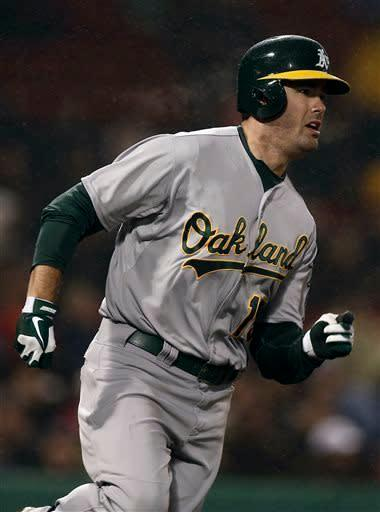 Oakland Athletics' Seth Smith runs out his home run against the Boston Red Sox during the fourth inning of a baseball game at Fenway Park in Boston Tuesday, April 23, 2013. (AP Photo/Winslow Townson)