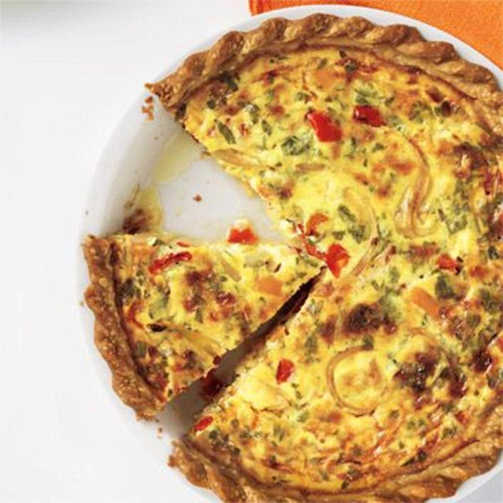 """<p>Prepare this colorful quiche with lots of cheese just for Dad.</p><p><a href=""""https://www.womansday.com/food-recipes/food-drinks/recipes/a11724/cheesy-bell-pepper-herb-quiche-recipe-wdy0912/"""" rel=""""nofollow noopener"""" target=""""_blank"""" data-ylk=""""slk:Get the Cheesy Bell Pepper and Herb Quiche recipe."""" class=""""link rapid-noclick-resp""""><em>Get the Cheesy Bell Pepper and Herb Quiche recipe.</em></a></p>"""