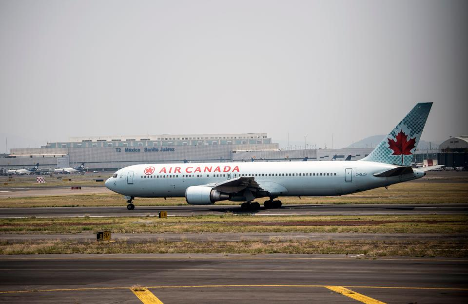 An Air Canada airlines plane prepares to take off at the Benito Juarez International airport, in Mexico City, on May 20, 2020, amid the new Covid-19 coronavirus pandemic. - From suspending all flights to reducing their employees' wages, Latin American airlines take extreme measures and cry for government aid in the face of the expansion of the coronavirus, which could leave them losses of 15,000 million dollars this year. (Photo by PEDRO PARDO / AFP) (Photo by PEDRO PARDO/AFP via Getty Images)