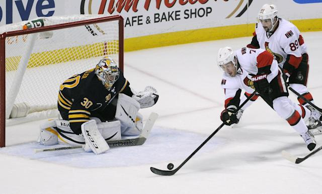 Buffalo Sabres goalie Ryan Miller (30) watches Ottawa Senators center Kyle Turris (7) as he reaches for the puck along with center Cory Conacher (89) during the first period of a NHL hockey game in Buffalo, N.Y., Friday, Oct. 4, 2013. (AP Photo/Gary Wiepert)