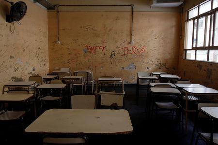 An empty classroom is seen at a public school as thousands of teachers took to the streets, delaying the first day of school for millions of children, as part of a two-day national strike demanding a wage increase, in Buenos Aires, Argentina. REUTERS/Martin Acosta