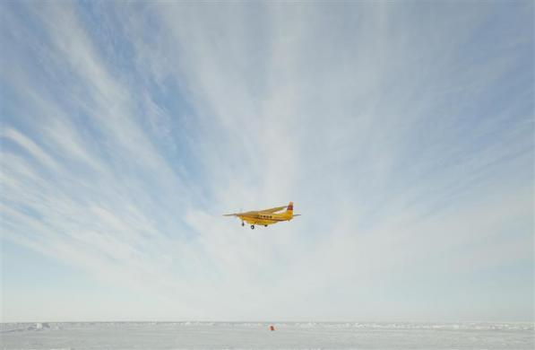 A plane takes off from an ice runway near the Applied Physics Lab Ice Station to return to Prudhoe Bay in the Arctic north of Prudhoe Bay, Alaska March 18, 2011.