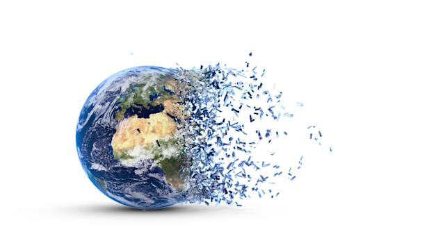 Disintegration of the world globe isolated on white background. Photo: Getty