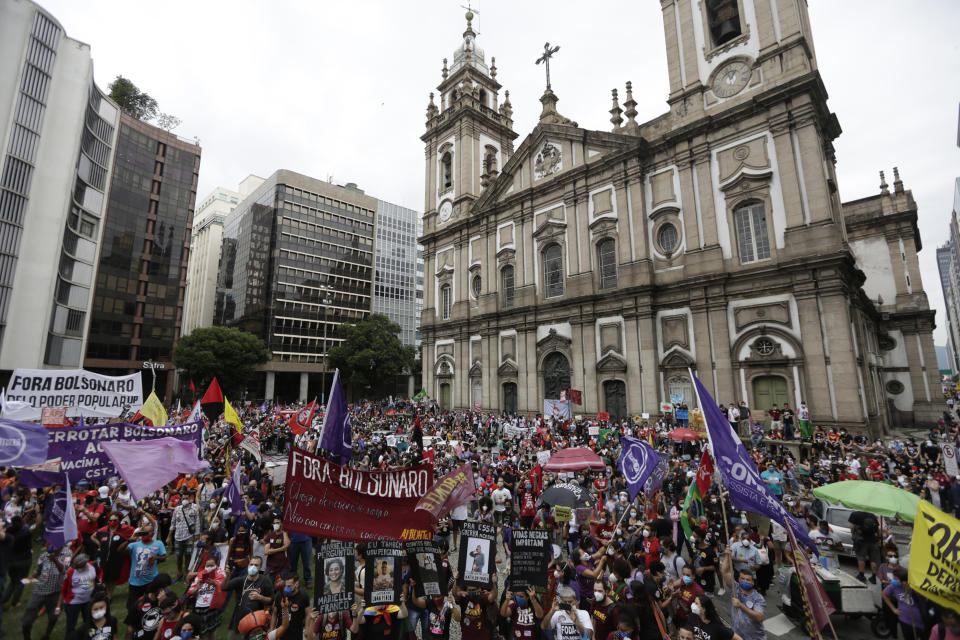 Demonstrators shouts slogans during a protest against Brazilian President Jair Bolsonaro and his handling of the coronavirus pandemic and economic policies they say harm the interests of the poor and working class, in Rio de Janeiro, Brazil, Saturday, June 19, 2021. Brazil is approaching an official COVID-19 death toll of 500,000 — second-highest in the world. (AP Photo/Bruna Prado)