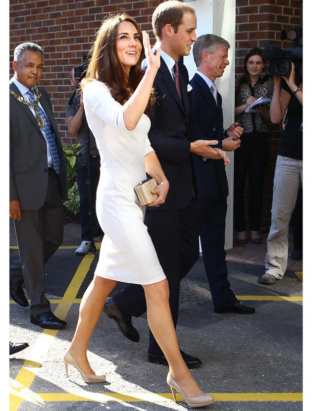 Kate Middleton photos: Fitted shift dresses are looks Kate loves and this off white number is no exception, she's a fully-fledged princess in this snap complete with her husband.