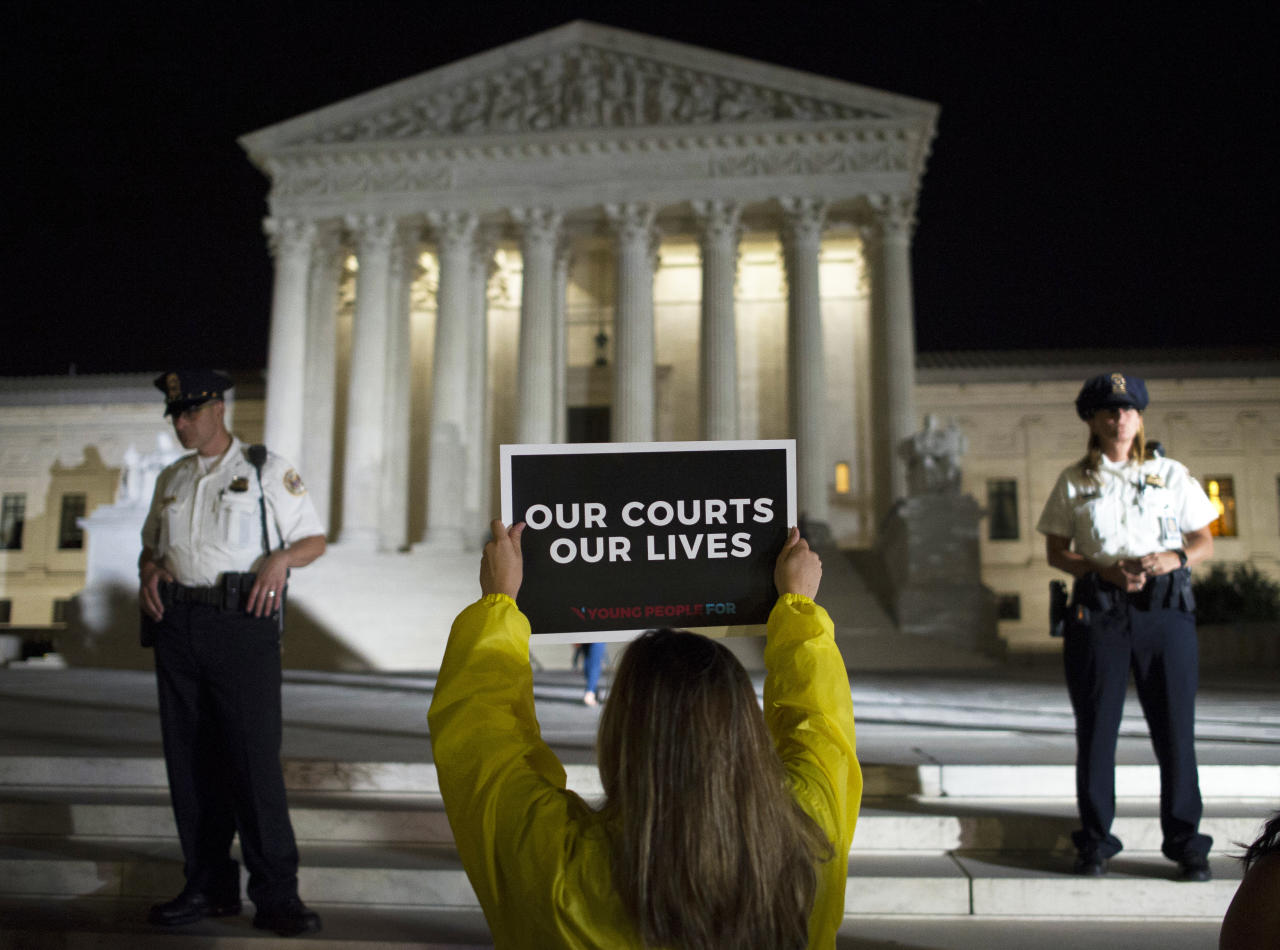 <p>A demonstrator protests in front of the Supreme Court as President Donald Trump announces Judge Brett Kavanaugh as his Supreme Court nominee in Washington, Monday, July 9, 2018. (Photo: Cliff Owen/AP) </p>