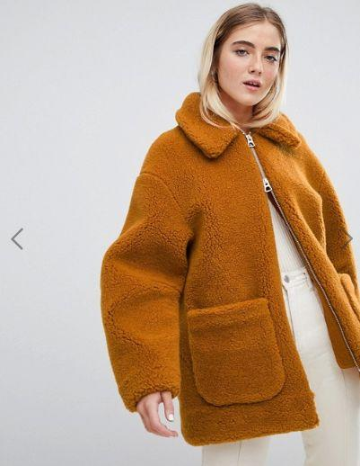 "This ochre teddy coat has a zip-front closure and front pockets. <strong><a href=""https://fave.co/2A5BhTr"" target=""_blank"" rel=""noopener noreferrer"">Find it for $143 at ASOS</a></strong>."