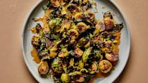 """These roasted brussels sprouts get a fair amount of spice from the crushed red pepper flakes, which cuts through the acidity and sweetness of the glaze, but if you're spice-averse, feel free to leave them out! <a href=""""https://www.bonappetit.com/recipe/roasted-brussels-sprouts-with-warm-honey-glaze?mbid=synd_yahoo_rss"""" rel=""""nofollow noopener"""" target=""""_blank"""" data-ylk=""""slk:See recipe."""" class=""""link rapid-noclick-resp"""">See recipe.</a>"""