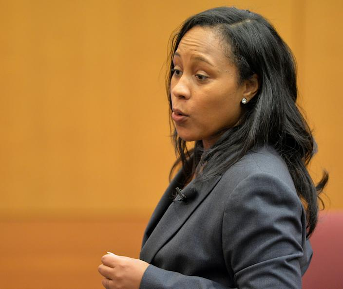 Fulton ADA Fani Willis makes the opening statement for the prosecution in a case against 12 former Atlanta Public Schools educators and administrators, in Atlanta, Monday, Sept. 29, 2014 in Fulton County Superior Court. Prosecutors said 12 former Atlanta Public Schools educators and administrators cheated, lied and stole as part of a widespread but cleverly disguised conspiracy to inflate state test scores that affected thousands of students. Prosecutors have agreed to plea deals with 21 other defendants included in the initial indictment. (AP Photo/Atlanta Journal-Constitution, Kent D. Johnson, Pool)