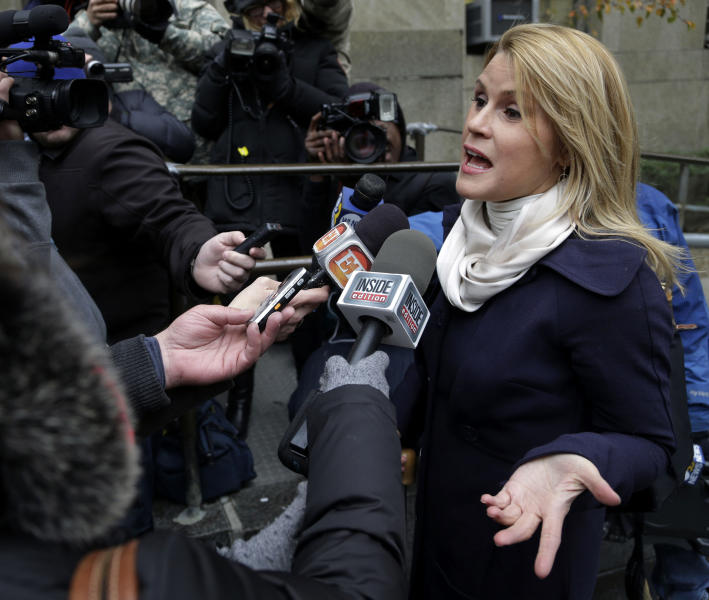 Genevieve Sabourin, who is charged with stalking actor Alec Baldwin, speaks with reporters as she arrives for her trial at criminal court Tuesday, Nov. 12, 2013, in New York. (AP Photo/Seth Wenig)