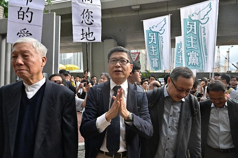 Baptist minister Chu Yiu-ming, law professor Benny Tai and sociology professor Chan Kin-man arrive at court on Tuesday (AFP Photo/Anthony WALLACE)