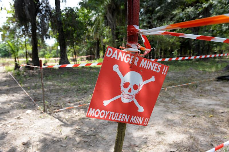 A sign warns locals of a minefield on December 3, 2009, in a village near Kaguit, in the southern Senegalese province of Casamance