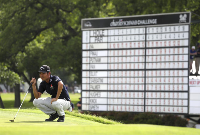 Kevin Na lineup his putt on the 18th green in the final round of the Charles Schwab Challenge golf tournament Sunday, May 26, 2019, in Fort Worth, Texas. (AP Photo/ Richard W. Rodriguez)