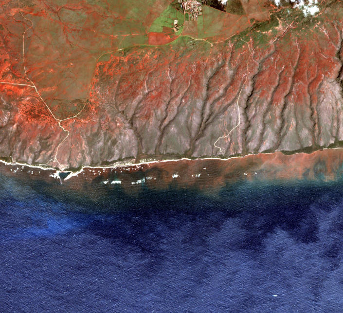 In this 2020 satellite image provided by the Arizona State University's Center for Global Discovery and Conservation Science, Allen Coral Atlas, runoff from the island of Molokai in Hawaii flows into the ocean. Recent flooding in Hawaii caused widespread and obvious damage. But extreme regional rain events that are predicted to become more common with global warming do not only wreak havoc on land, the runoff from these increasingly severe storms is also threatening Hawaii's coral reefs. (Arizona State University's Center for Global Discovery and Conservation Science, Allen Coral Atlas via AP)