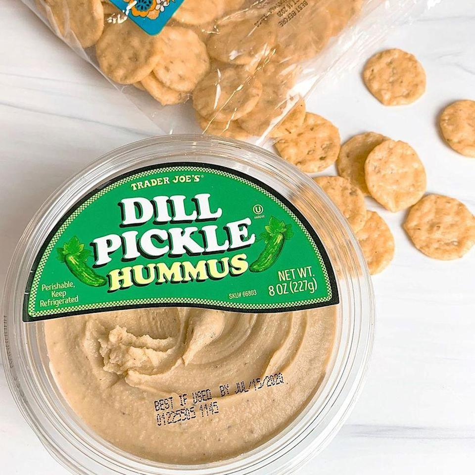 """<p>Trader Joe's has taken the vinegar, sea salt, and savory spices you love in a pickle and put it in spreadable form. The <a href=""""https://www.traderjoes.com/digin/post/dill-pickle-hummus"""" rel=""""nofollow noopener"""" target=""""_blank"""" data-ylk=""""slk:Dill Pickle Hummus"""" class=""""link rapid-noclick-resp"""">Dill Pickle Hummus</a> is made with garbanzo beans that are cooked with whole dill pickles, and mixed with tahini, extra virgin olive oil, sea salt, dried onion and garlic, black pepper, and dill weed. Is anyone else's mouth watering for this $1.99 find?</p>"""