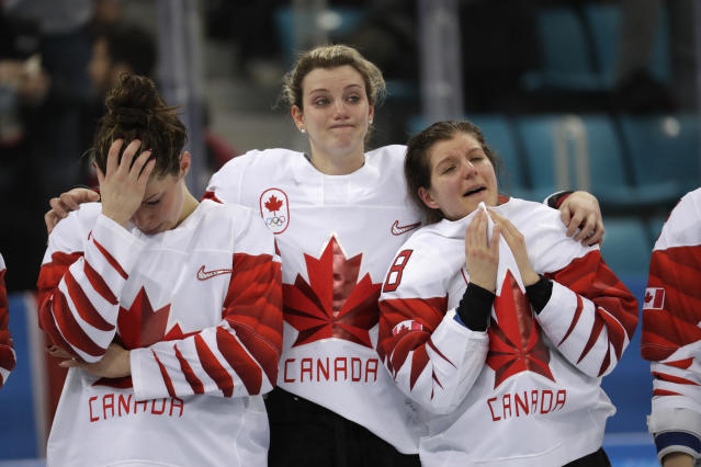 <p>Team Canada, silver, react during the medals ceremony for women's hockey at the 2018 Winter Olympics in Gangneung, South Korea, Thursday, Feb. 22, 2018. (AP Photo/Julio Cortez) </p>