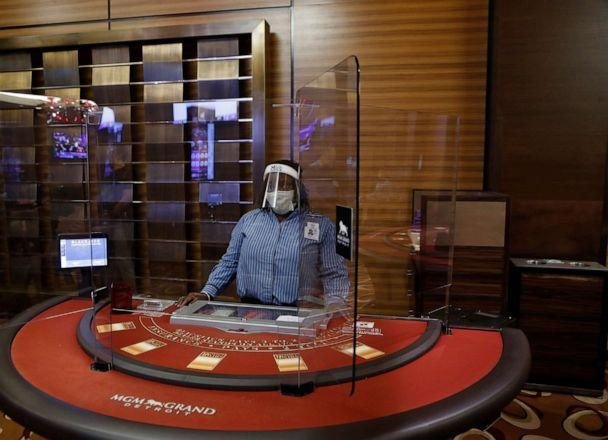 PHOTO: Plexiglass surrounds a blackjack dealer at the MGM Grand Detroit casino, Aug. 5, 2020, in Detroit. (Carlos Osorio/AP)