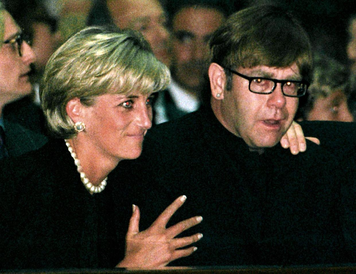 FILE PHOTO 22JUL97 - Diana, Princess of Wales and pop star Elton John attend a memorial mass for Italian fashion designer Gianni Versace in Milan Cathedral July 22. Rock superstar Elton John will sing at her funeral on Saturday before a worldwide television audience expected to run into hundreds of millions. Elton John said in a television interview that he will do all he can not to cry when he performs at the funeral of his friend Diana.  DIANA ELTON