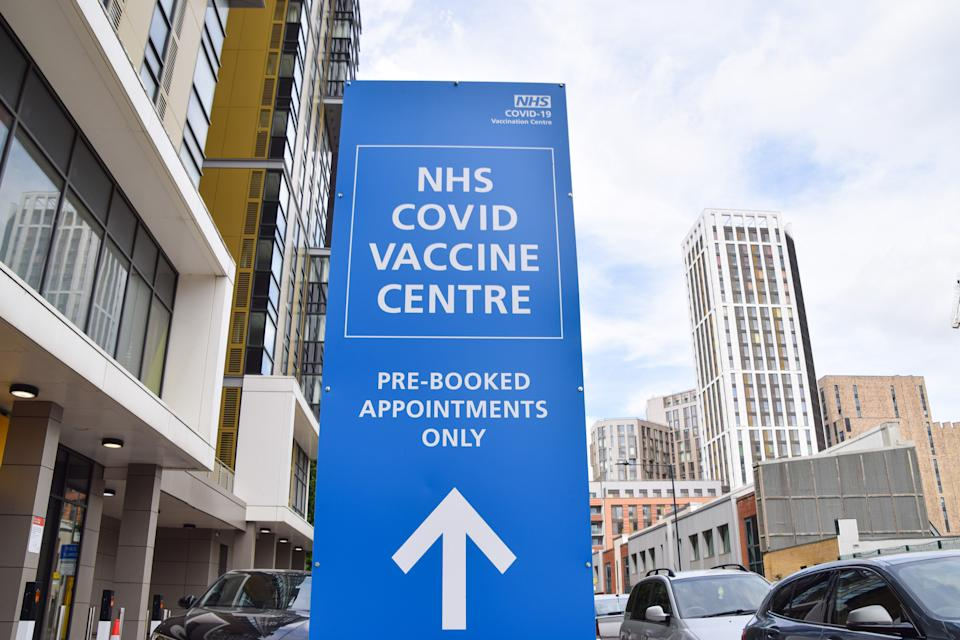 LONDON, UNITED KINGDOM - 2021/06/11: NHS covid-19 Vaccine Centre sign seen in Wembley, London.  Over 70 million coronavirus vaccination doses have been given in the UK to date, and over half of the adults have received their second dose. (Photo by Vuk Valcic/SOPA Images/LightRocket via Getty Images)