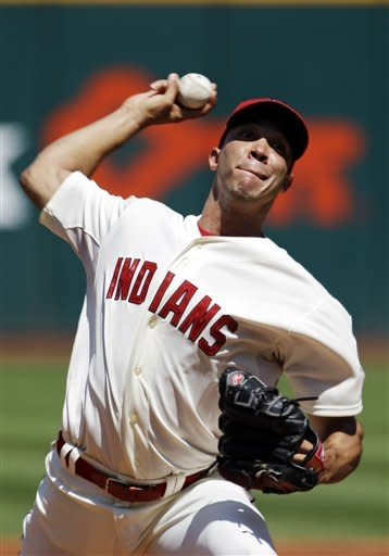 Cleveland Indians starting pitcher Ubaldo Jimenez delivers against the New York Yankees in the first inning of a baseball game on Sunday, Aug. 26, 2012, in Cleveland. (AP Photo/Mark Duncan)