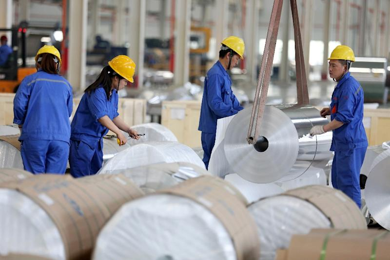 Beijing is worried by a growing list of foreign and Chinese firms moving production and factories abroad (AFP Photo/STR)
