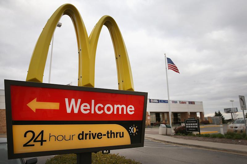 DES PLAINES, IL - OCTOBER 24: A sign directs customers to the drive-thru at a McDonald's restaurant on October 24, 2013 in Des Plaines, Illinois. McDonald's has announced it will make changes to its low-priced Dollar Menu, which includes items like coffee, small fries, hamburgers and apple pies. The new menu, dubbed the Dollar Menu and More, will offer some higher priced options such as the grilled Onion Cheddar Burger and a McChicken sandwich. (Photo by Scott Olson/Getty Images)