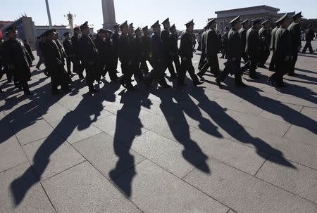 File photo of military delegates walking towards the Great Hall of the People for a plenary meeting of the NPC in Beijing
