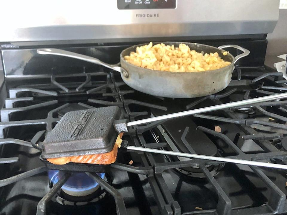 Camping press on the stove for Guy Fieri's grilled cheesse