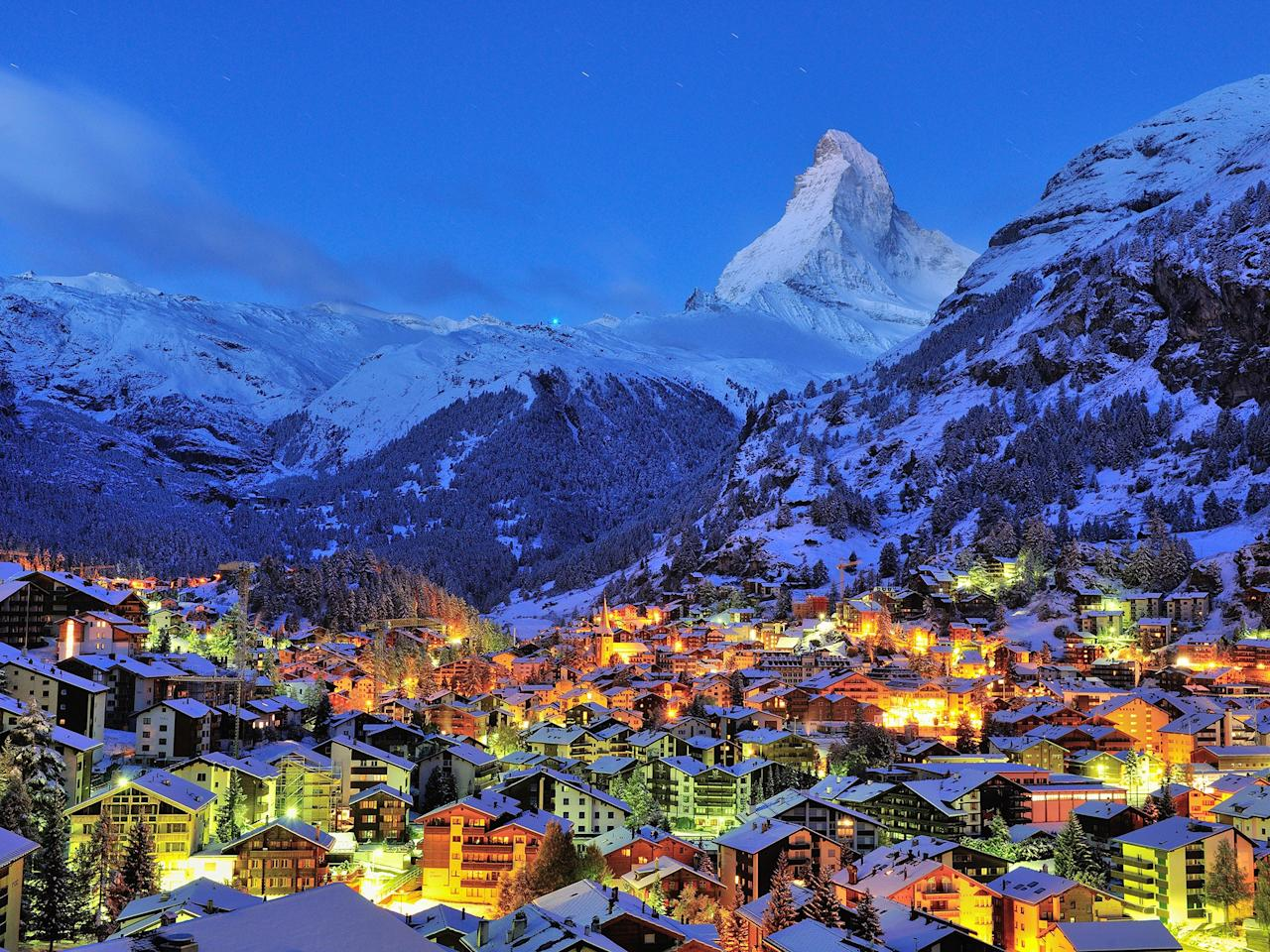 """<p>Experience classic Switzerland at the foot of the country's iconic Matterhorn mountain, which soars 14,692 feet above sea level in a stunning, pyramid shape. Found in Valais, just six miles from the Theodul Pass, which borders Italy, Zermatt is never short of fresh powder, avid skiers, and views of some of the highest peaks in the country. Shops, cafes, bars, and restaurants line the bustling main street in town, Bahnhofstrasse, where you can partake in après-ski as it was meant to be enjoyed: warm, cozy, and with plenty of apple strudel.</p> <p><strong>Stats:</strong> Priced from around $82, a day pass to Zermatt will have you zooming down your pick of 147 different runs. With 54 lifts and 224 miles of powder, there's a little something for skiers of all abilities. Heli-skiing is also on offer, if that's more your style.</p> <p><strong>Where to eat and drink nearby:</strong> You won't go hungry at Zermatt. In addition to the nightlife along Bahnhofstrasse, local resorts offer some of the best dining options in the country. Sip espresso by the fire at <a href=""""http://www.cntraveler.com/hotels/switzerland/zermatt/the-omnia?mbid=synd_yahoo_rss"""" target=""""_blank"""">The Omnia</a>'s restaurant to defrost, enjoy traditional drinks and cocktails at the <a href=""""http://www.cntraveler.com/hotels/switzerland/gornergrat/grand-hotel-zermatterhof--zermatt?mbid=synd_yahoo_rss"""" target=""""_blank"""">Grand Hotel Zermatterhof</a>'s Star Bar, and refuel with some of the top alpine cuisine at Brasserie Lusi. Grand Hotel Zermatterhof even offers its very own cheese cafe.</p> <p><strong>Where to stay:</strong> Make yourself at home off the slopes at The Omnia, the sprawling Grand Hotel Zermatterhof, the splurge-worthy <a href=""""https://www.montcervinpalace.ch/en"""" target=""""_blank"""">Mont Cervin Palace</a>, or cozy <a href=""""https://www.cntraveler.com/hotels/switzerland/gornergrat/backstage?mbid=synd_yahoo_rss"""" target=""""_blank"""">Backstage</a>, just steps from the Glacier Express train, which connects S"""