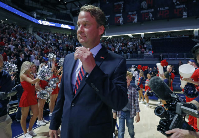 Lane Kiffin waves to fans as he enters The Pavilion, a multipurpose arena on the campus, to be introduced to Mississippi fans as the new NCAA college football coach, in Oxford, Miss., Monday, Dec. 9, 2019. Kiffin was previously, the football coach for three years at Florida Atlantic. (AP Photo/Rogelio V. Solis)
