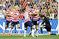 Sydney Leroux #11, Megan Rapinoe #15 and Lauren Cheyney #12 of the USA congratulate teammate Abby Wambach #20 on a second half goal in front of Zhang Yue #1 of the China at PPL Park on May 27, 2012 in Chester, Pennsylvania. USA won 4-1. (Photo by Drew Hallowell/Getty Images)
