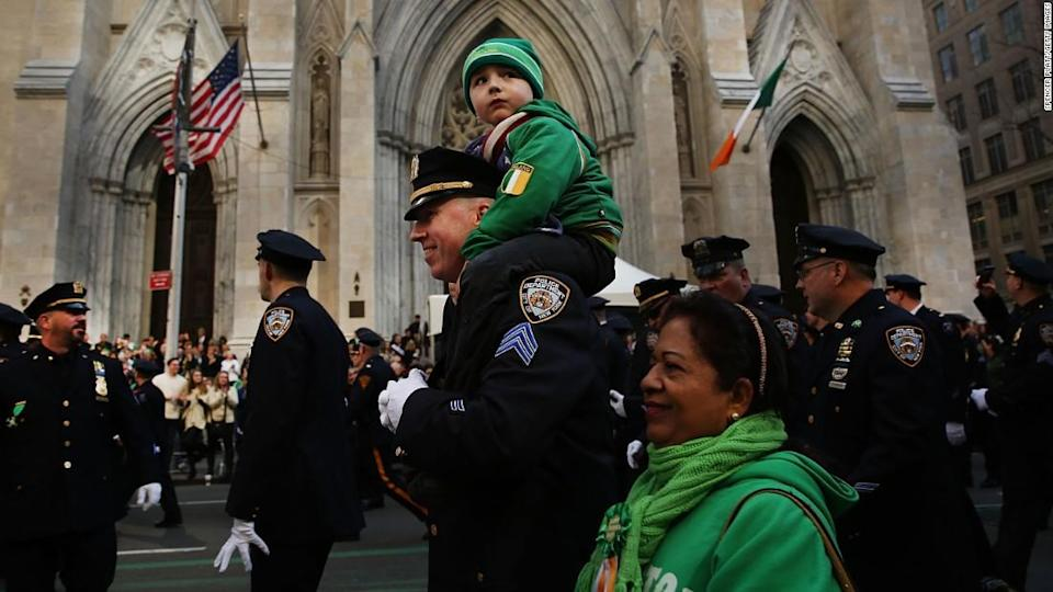 "<p>In 2016, an NYPD officer marches with his son past Manhattan's St. Patrick's Cathedral in the annual St. Patrick's Day Parade.</p><div class=""cnn--image__credit""><em><small>Credit: Spencer Platt/Getty Images / Getty</small></em></div>"