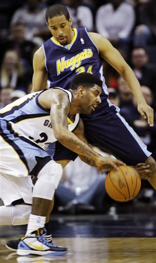 Memphis Grizzlies shooting guard O.J. Mayo (32) drives under Denver Nuggets point guard Andre Miller (24) during the first half of an NBA basketball game in Memphis, Tenn., Friday, Feb. 17, 2012. (AP Photo/Danny Johnston)