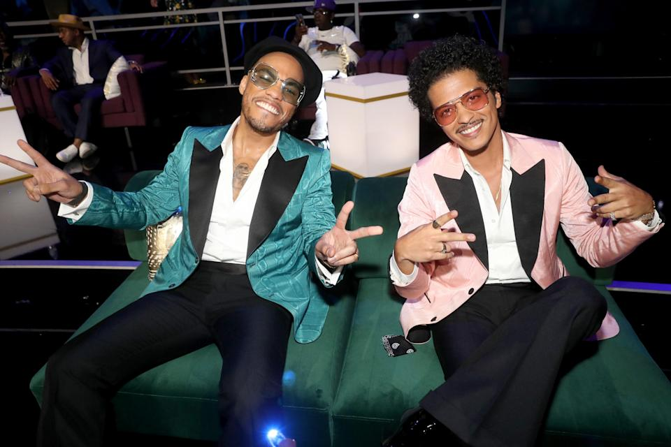 The powerhouse singers, known by their joint stage moniker Silk Sonic, were all smiles in their matching aqua and pink blazers and sunglasses.