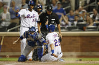 Los Angeles Dodgers catcher Will Smith, beflow left, applies a late tag on New York Mets' J.D. Davis, (28) who scores on Brandon Nimmo's two-run triple during the second inning of a baseball game, Sunday, Sept. 15, 2019, in New York. Mets' Robinson Cano, above left, also scored on the play. Home plate umpire Vic Carapazza watches the plate. (AP Photo/Kathy Willens)