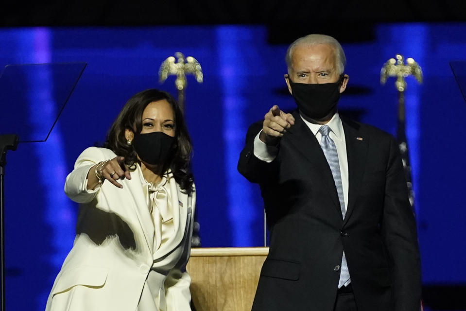 From left, Doug Emhoff, husband of Vice President-elect Kamala Harris, Harris, President-elect Joe Biden and his wife Jill Biden on stage together, Saturday, Nov. 7, 2020, in Wilmington, Del. (AP Photo/Andrew Harnik, Pool)