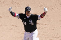 Chicago White Sox's Yasmani Grandal celebrates his game winning single during the 10th inning of a baseball game against the Tampa Bay Rays Wednesday, June 16, 2021, in Chicago. (AP Photo/Charles Rex Arbogast)