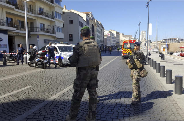 <p>Armed soldiers on the scene after a van rammed into two bus stops in Marseille, France, Aug. 21, 2017. (Photo: David Coquille/AP) </p>