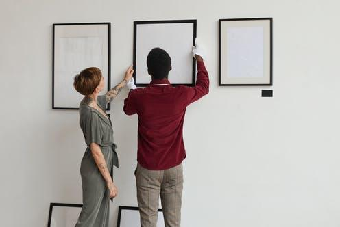"""<span class=""""caption"""">Anonymous accounts of racism in gallery spaces criticise the industry for failing to tackle systemic discrimination</span> <span class=""""attribution""""><a class=""""link rapid-noclick-resp"""" href=""""https://www.shutterstock.com/image-photo/back-view-portrait-two-art-gallery-1831863697"""" rel=""""nofollow noopener"""" target=""""_blank"""" data-ylk=""""slk:SeventyFour/Shutterstock"""">SeventyFour/Shutterstock</a></span>"""