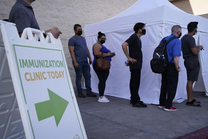 People wait in line for COVID-19 vaccinations at an event at La Bonita market, a Hispanic grocery store, Wednesday, July 7, 2021, in Las Vegas. (AP Photo/John Locher)